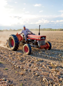 """That 135 is the most balanced tractor,"" says Robert. ""It turns around on a dime"""