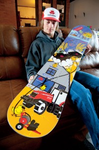 Mitch shows off one his most prized boards, complete with a drawing of a Massey Ferguson tractor.
