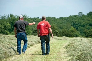 Hammann walks with his son, Jason, who kicks in some much-needed help at harvest time.