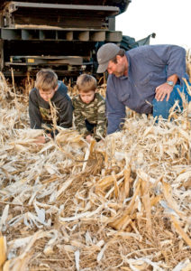 "There's a fine line related to combine settings with popcorn, says Malmkar, who's seen here with sons Zack and Josh. It's hard to shell off the cob, yet delicate. ""You have to sacrifice a little yield for high quality."""