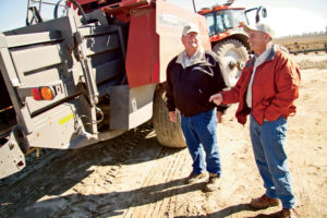 Rietkerk with his Massey Ferguson dealer, Gary Garrett (left).