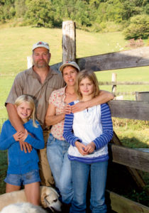 "Stephen and Dawn Robertson with daughters Madison (left), 11, and Autumn (right), 12. ""We depend on them"" around the farm, Stephen says."