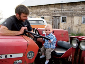 Jan Broeders with his son, Malcolm, two farmers who've recieved assistance from NFP.