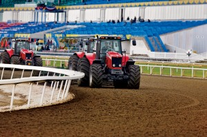Crews use Massey Ferguson 5400 Series tractors on the Standardbred track for pulling harrows through the crushed traprock, referred to as hard dirt, keeping it smooth and level.