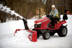 With four-wheel drive, the tractor pushes right through snow, and doesn't spin its wheels.