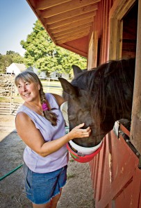Dee Doolittle says horses at Mitchell Farm learn that human touch doesn't mean work anymore.