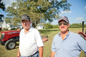 Proving he listened to advice from his father, Arthur (left), Paul Black recently purchased his own Massey Ferguson tractor, an MF2615.