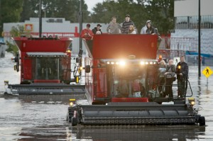 Farmway personnel waded through waist-deep floodwaters to three Massey Ferguson combines.