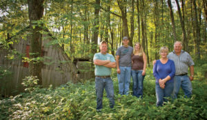 Tending to the sugar bush requires year-round forestry management, as well as tending to 250 miles of vacuum tubing. Seen here in late summer: Devin, Nick, Lauren, Hope and Mark.