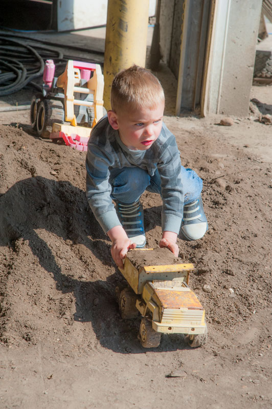 Logan, Dwayne's youngest, plays on the farm.