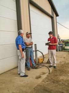 NY FarmNet financial consultant Bill Sanok, farmer Phil Schmitt and Edward Staehr.
