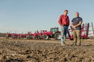 Bob and Darren Littleton with their full line of AGCO equipment.