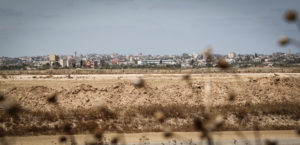 Seen from atop an Israeli tank ramp: A no-man's land, the border fence, and Gaza just beyond.