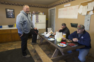 Jason Schwab with the guys in the break room at his dairy.