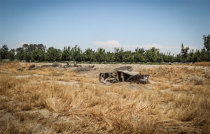 Sitting on what was once the bottom of a pond near Hanford, California, a boat suffers from a sort of dry rot-induced atrophy.