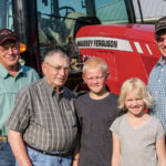 The two children are the fourth generation on the farm