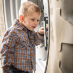 "Jason's son Chase ""checks"" the equipment before it heads to the fields."