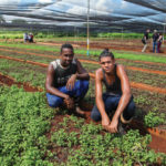 Vivero Alamar employees Ronnier and Alfredo with mint plants.