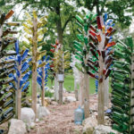 "The farm's sign and bottle trees welcome visitors to what many call a ""peaceful"" place."